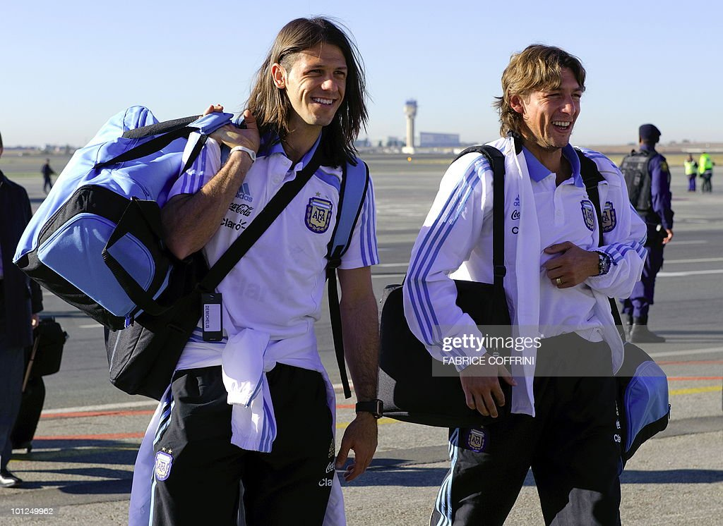 Argentinian national football team players Martin Demichelis (L) and Gabriel Heinze leave their plane upon their team's arrival at O. R. Tambo international airport on May 29, 2010 in Johannesburg ahead of the 2010 FIFA World Cup in South Africa. Argentina will play their first match against Nigeria on June 12.