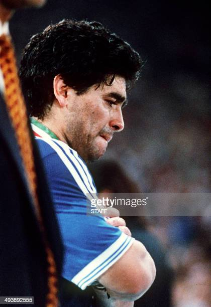 Argentinian national soccer team captain and midfielder Diego Maradona cries after his team lost to West Germany 1-0 on a penalty kick by defender...