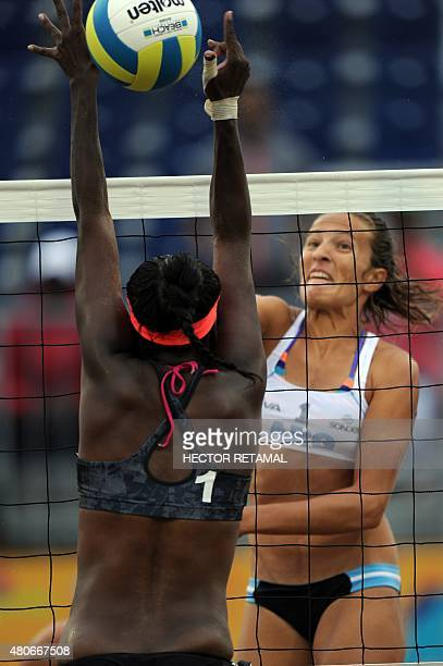 Argentinian player Ana Gallay vies for the ball with Ayana Dyette during the Women's Beach Volleyball Preliminary against Trinidad and Tobago at the...