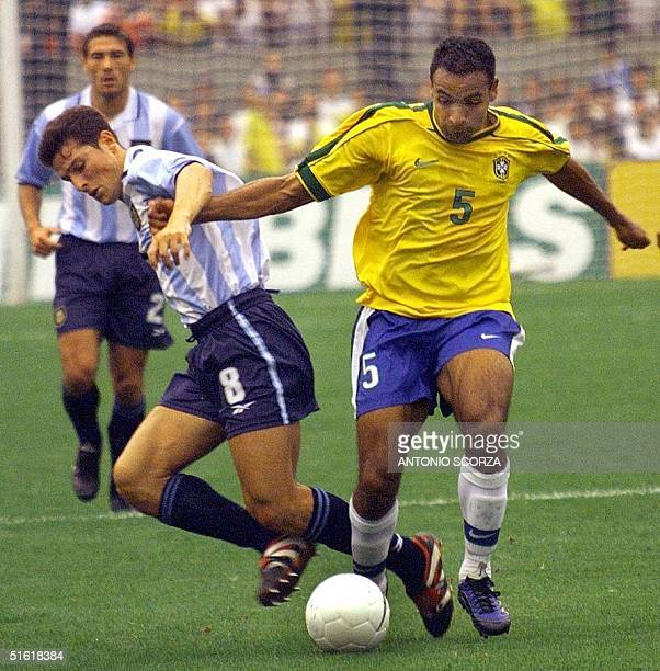 Argentinian player Javier Zanetti struggles for the ball with Brazilean player Emerson 07 September 1999 during a friendly game between the teams...