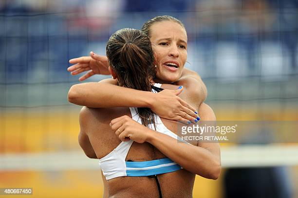 Argentinian players Ana Gallay and Georgina Klug celebrate a point during the Women's Beach Volleyball Preliminary against Trinidad and Tobago at the...