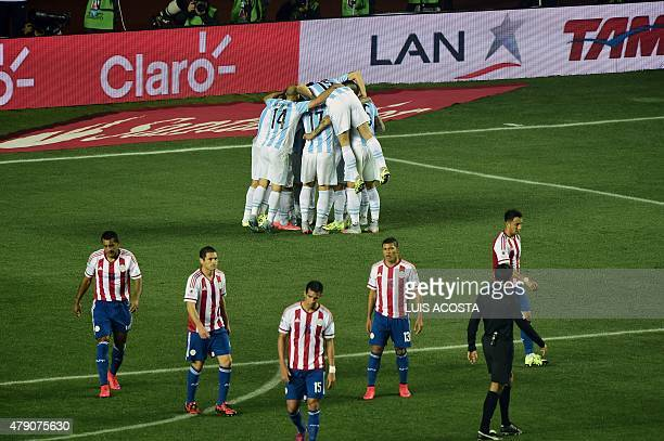 Argentinian players celebrate after scoring against Paraguay during their Copa America semifinal football match in Concepcion, Chile on June 30,...
