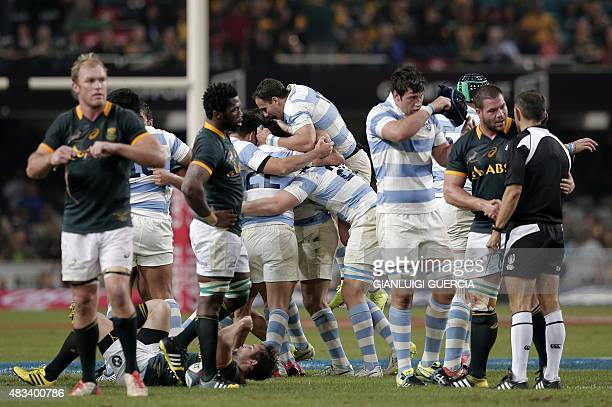 Argentinian players celebrate after winning against South African Springboks at the end of the Rugby Championship Test match between South Africa and...