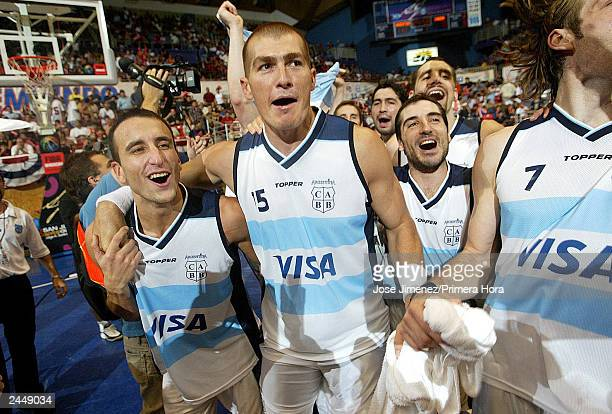 OUT *** Argentinian players Emanuel Ginobili Ruben Wolkowisky and Alejandro Montecchia celebrate after Argentina defeated Canada 8872 for the...