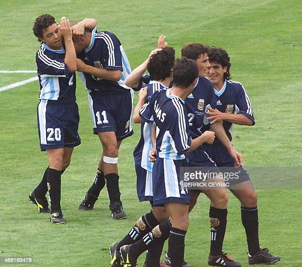 Argentinian players jubilate after defender Hector Pineda scored 26 June at Parc Lescure stadium in Bordeaux during the 1998 Soccer World Cup group H...