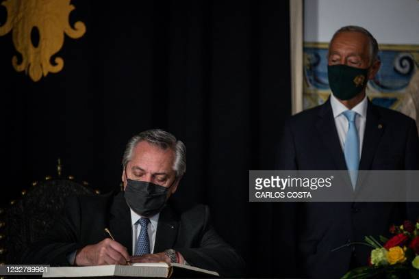 Argentinian president Alberto Fernandez signs on the honour book under the eyes of Portuguese President Marcelo Rebelo de Sousa at the Belem Palace...