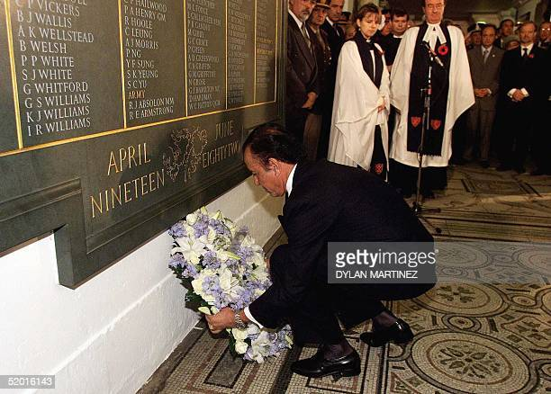 Argentinian President Carlos Menem lays a wreath 28 October in front of the memorial plaque at St Paul's Cathedral during the remembrance service was...
