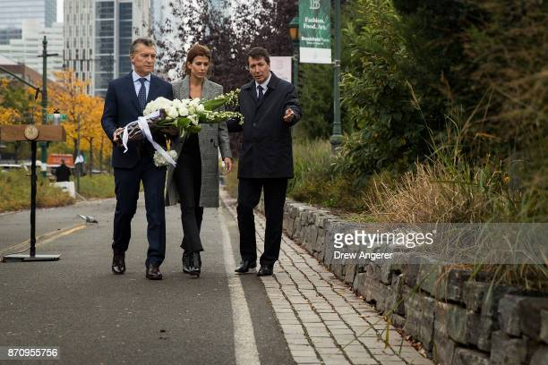 Argentinian President Mauricio Macri and First Lady of Argentina Juliana Awada carry flowers as they attend a tribute for the victims of last week's...