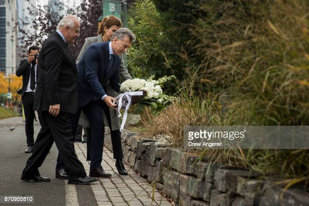 Argentinian President Mauricio Macri and First Lady of Argentina Juliana Awada lay flowers as they attend a tribute for the victims of last week's...