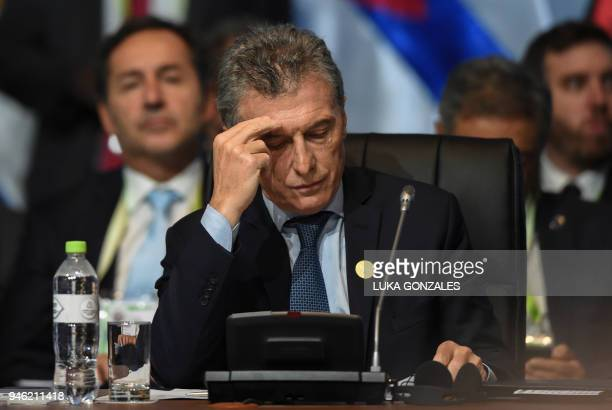 Argentinian President Mauricio Macri attends the plenary session of the Eighth Americas Summit in Lima on April 14 2018 US strikes on Syria...