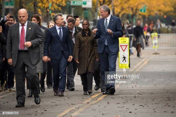 Argentinian President Mauricio Macri Chirlane McCray and New York City Mayor Bill de Blasio walk along a bike path next to the West Side Highway as...
