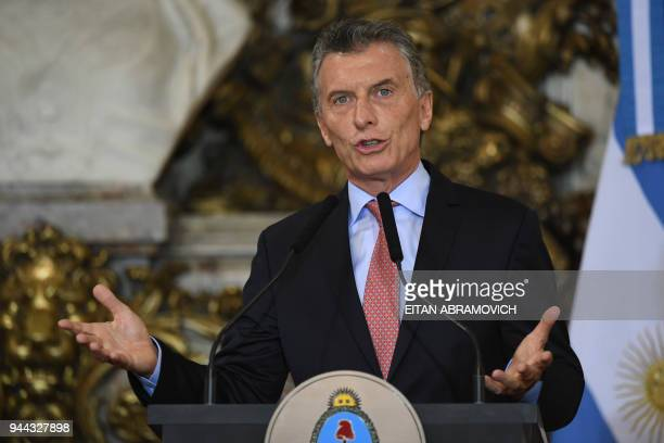 Argentinian President Mauricio Macri gestures as he speaks during a joint press conference with Spanish Prime Minister Mariano Rajoy at the Casa...