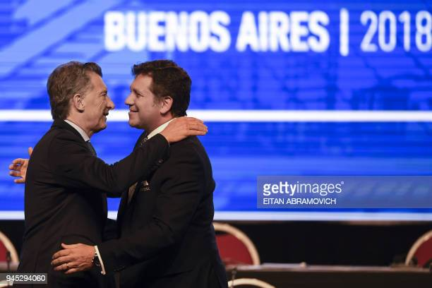 Argentinian President Mauricio Macri is greeted by Conmebol President Alejandro Dominguez during the 68th Conmebol Council meeting in Buenos Aires...