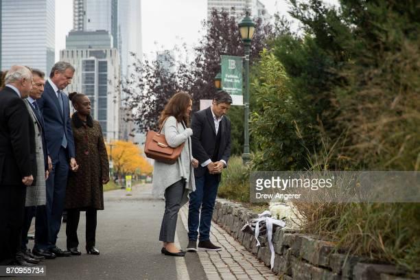 Argentinian President Mauricio Macri New York City Mayor Bill de Blasio and Chirlane McCray look on as attack survivor Guillermo Banchini and a...