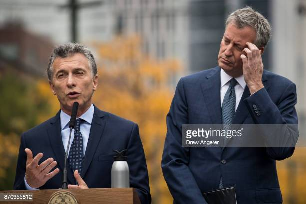 Argentinian President Mauricio Macri speaks as New York City Mayor Bill de Blasio looks on during a tribute for the victims of last week's vehicular...