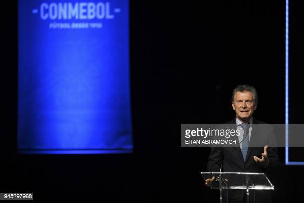 Argentinian President Mauricio Macri speaks during the 68th Conmebol Council meeting in Buenos Aires Argentina on April 12 2018 / AFP PHOTO / EITAN...