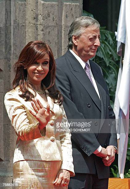 Argentinian presidential candidate Cristina Fernandez waves to press as she accompanies her husband President Nestor Kirchner during a welcoming...