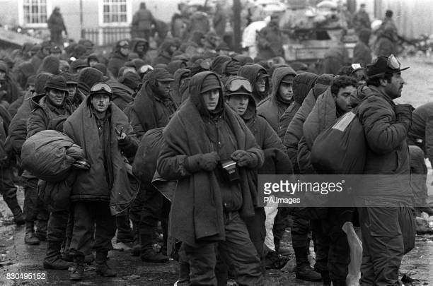 Argentinian prisoners of war feeling the cold beig transferred from the capital Port Stanley to the airport and thence to the requisitioned PO liner...
