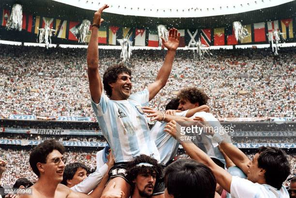 Argentinian Ricardo Giusti celebrates as he is carried by fans following Argentina's victory over West Germany in the World Cup soccer final 29 June...