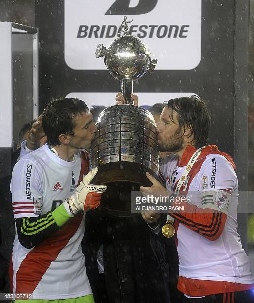 Argentinian River Plate Fernando Cavenaghi and goalkeeper Marcelo Barovero kiss the Libertadores Cup trophy after winning the second leg final match...