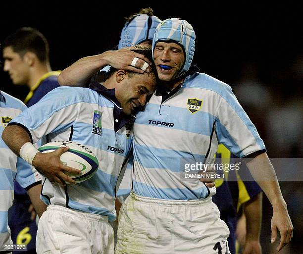 Argentinian scrumhalf Nicolas Fernandez Miranda is congratulated by his teammate Argentinian center Manuel Contepomi after scoring a try during the...
