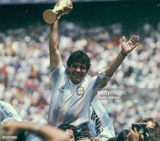 Argentinian soccer ace Diego Maradona lifts the trophy after Argentina was crowned world champion of the 1986 World Cup at the Azteca Stadium in...