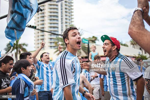 argentinian soccer fans celebrating - stock image - argentina stock pictures, royalty-free photos & images