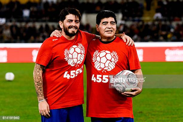 Argentinian soccer legend Diego Armando Maradona poses with his son Diego Armando Maradona jr during the 'Match of Peace United for Peace' charity...