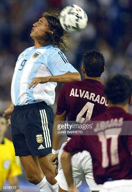 Argentinian soccer player Hernan Crespo jumps for the ball with Venezuelan Wilfredo Alvarado 09 September 2003 in Caracas during their qualifying...