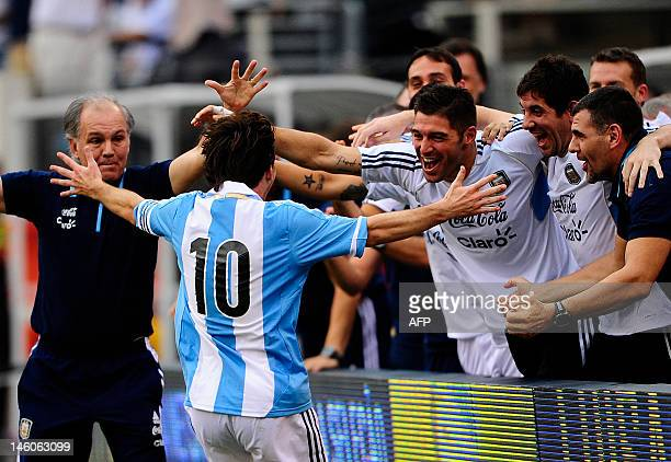 Argentinian soccer player Lionel Messi celebrates after scoring his third goal during a friendly match against Brazil at the MetLife Stadium in East...