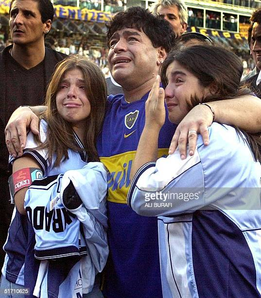 Argentinian soccer star Diego Maradona his daughters Dalma Nerea and Giannina Dinora are overcome with emotion during an event in Maradona's honor at...