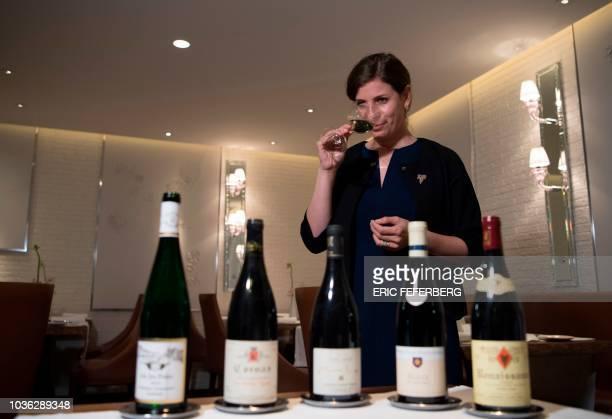 Argentinian sommelier Paz Levinson tastes wine in the restaurant 'La Dame de Pic' on September 14 2018 in Paris Paz Levinson is head sommelier for...