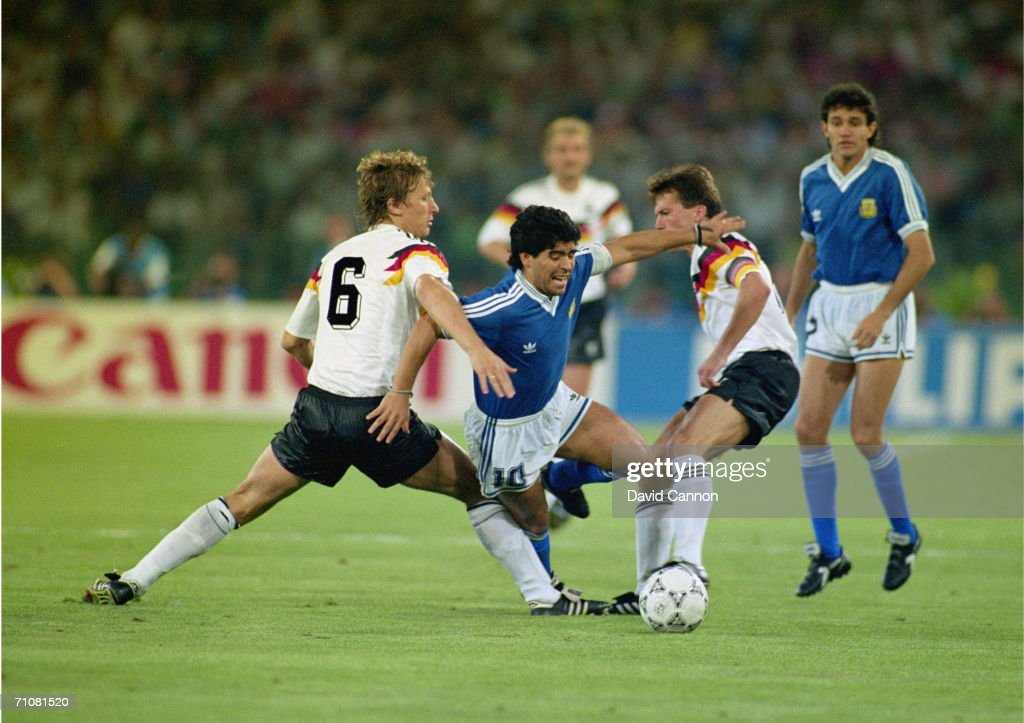 Argentinian striker Diego Maradona is challenged by Guido Buchwald (number 6), and Lothar Mattheus during the 1990 World Cup final at the Olimpico Stadium in Rome, 8th July 1990. West Germany won the match 1-0.