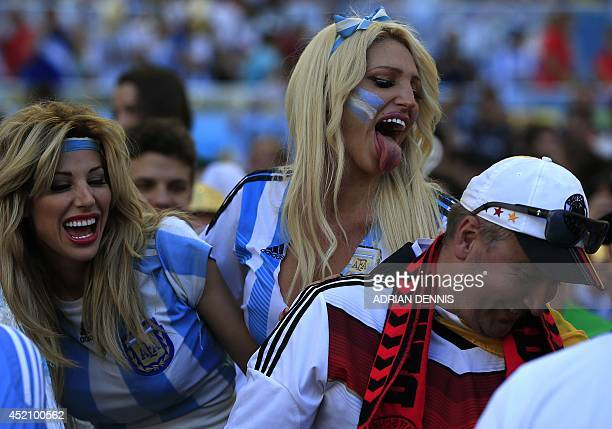 Argentinian supporters cheer for their team ahead of the final football match between Germany and Argentina for the FIFA World Cup at The Maracana...