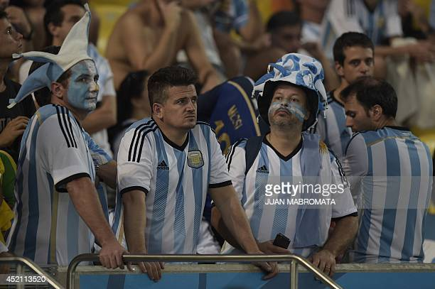 Argentinian supporters look on after their team's defeat in the final football match between Germany and Argentina for the FIFA World Cup at The...