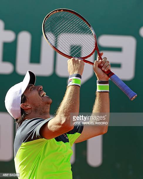 Argentinian tennis player Carlos Berlocq celebrates his victory over Czech Republic tennis player Tomas Berdych during the Portugal Open final at...