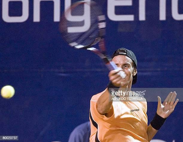 Argentinian tennis player Juan Ignacio Chela returns the ball to Uruguayan tennis player Pablo Cuevas during their Acapulco ATP Open match in...