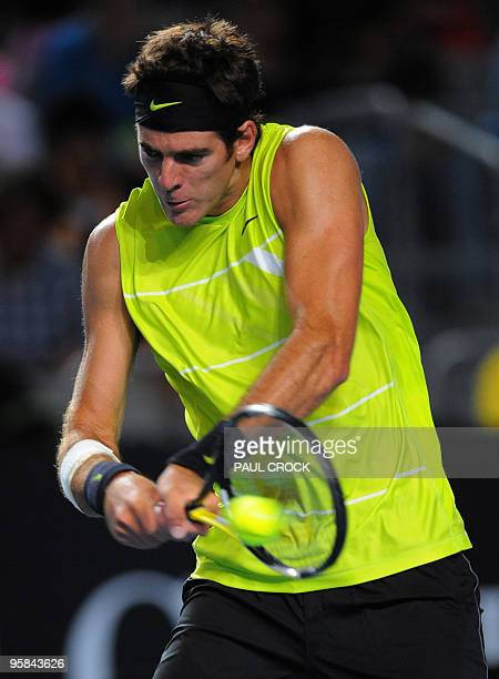 Argentinian tennis player Juan Martin Del Potro plays a backhand return during his men's singles match against US opponent Michael Russell on the...