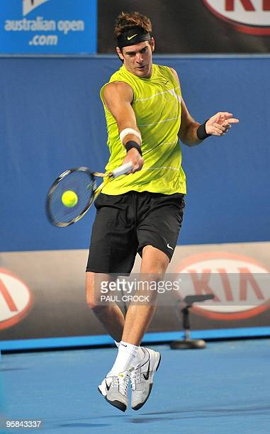 Argentinian tennis player Juan Martin Del Potro plays a forehand return during his men's singles match against US opponent Michael Russell on the...