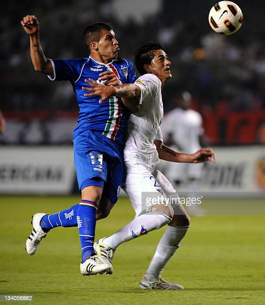 Argentinian Velez Sarsfield's Hector Canteros vies for the ball with Ecuadorean Liga de Quito's Norberto Araujo during their Copa Sudamericana...