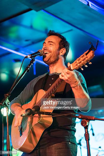 ArgentinianAmerican rock musician Kevin Johansen plays guitar as he performs at the 12th Annual GlobalFest on the Marlin Room Stage at Webster Hall...