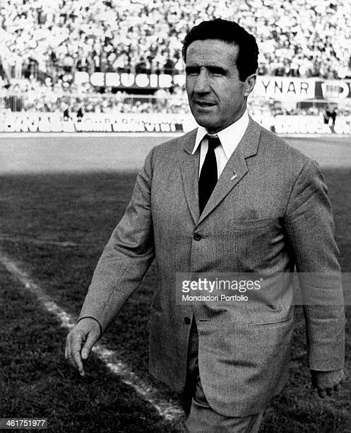 Argentinianborn French coach Helenio Herrera swalking on the playground during the match of the Italian Serie A championship BolognaInter Bologna 1st...