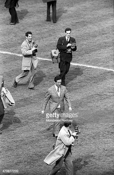 Argentinianborn French football player and coach Helenio Herrera walking on the football ground after the match between Italian football teams...