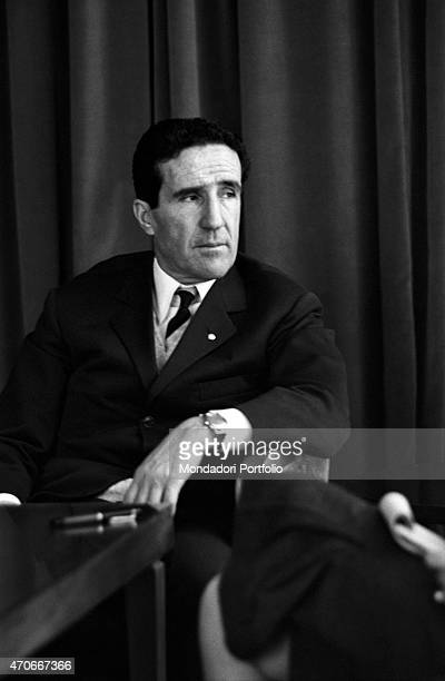 Argentinianborn French football trainer Helenio Herrera sits in an armchair at a table and gazes into the distance he nicknamed The Wizard is...