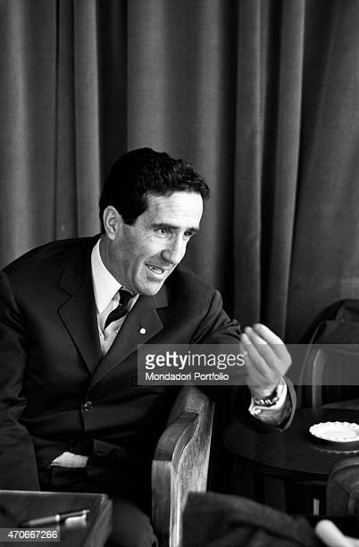 Argentinianborn French football trainer Helenio Herrera sitting in an armchair gesticulates during a conversation he nicknamed The Wizard is...
