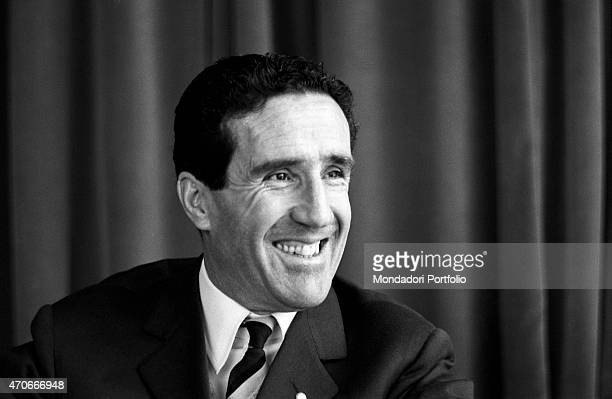 Argentinianborn French football trainer Helenio Herrera smiles gazing into the distance he nicknamed The Wizard is wellknown for the resounding...