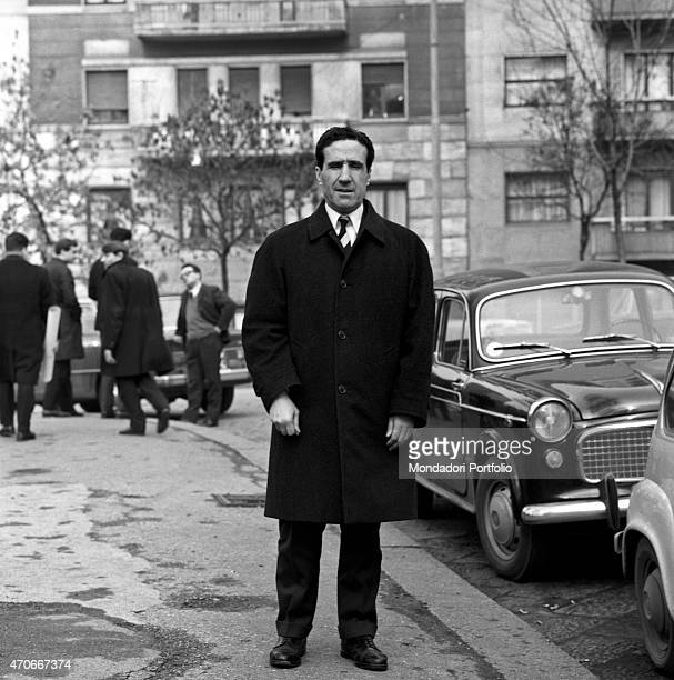 Argentinianborn French football trainer Helenio Herrera stands on the sidewalk beside some parked cars he nicknamed The Wizard is wellknown for the...