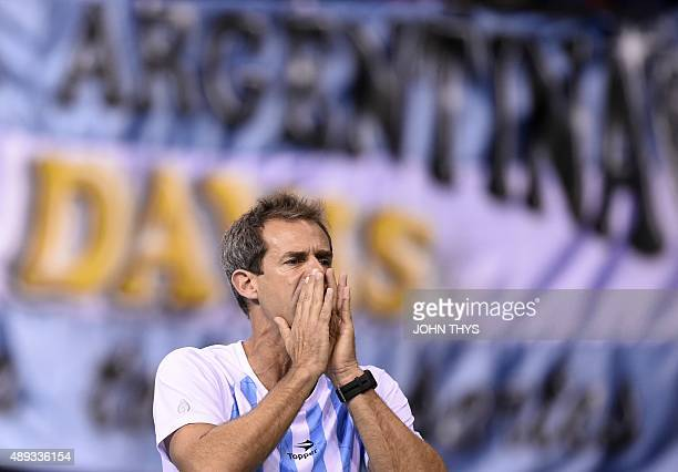 Argentinia's Captain Daniel Orsanic reacts during the Davis cup semifinal against Belgium's Steve Darcis at the Forest National Arena on September 20...