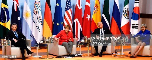 Argentinia's President Mauricio Macri German Chancellor Angela Merkel US President Donald Trump and Britain's Prime Minister Theresa May sit at the...