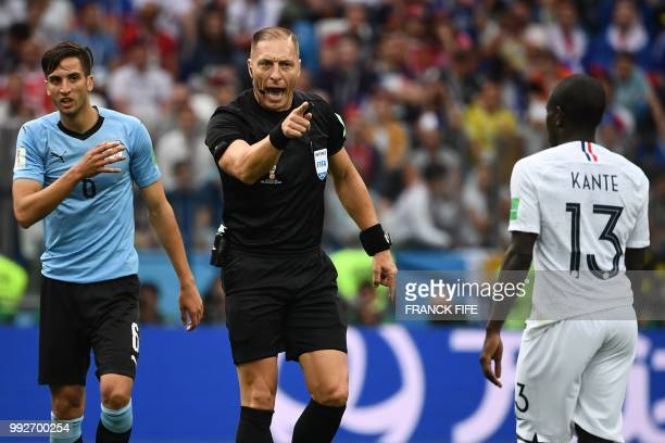 Argentininian referee Nestor Pitana gestures to France's midfielder N'Golo Kante during the Russia 2018 World Cup quarterfinal football match between...
